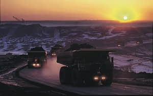 large mining trucks at construction site