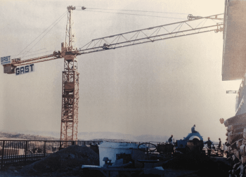 Old photo of crane on construction site