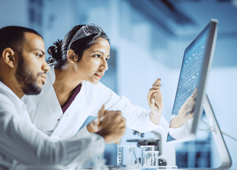 Scientists looking at a computer
