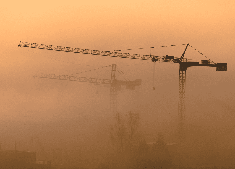 construction cranes in dust
