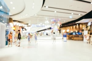 Abstract blur and bokeh defocused shopping mall interior of department store for background